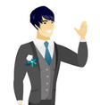 young asian groom waving his hand vector image vector image