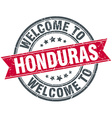 welcome to Honduras red round vintage stamp vector image vector image