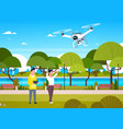 young people playing with drone copter in park man vector image vector image