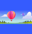 hot air balloons flying above pond field rocks vector image