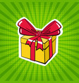 a box with a gift in pop art style vector image