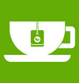 cup of tea with tea bag icon green vector image vector image