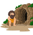 cartoon caveman sitting with cave background vector image vector image