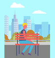 man sitting alone on bench in city park vector image