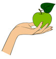 womans hand with a green apple isolated on white vector image