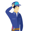 young asian mechanic scratching his head vector image vector image