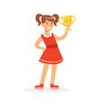happy school girl in red dress holding winner cup vector image vector image