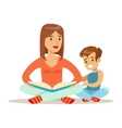 Mom And Son Reading Book Loving Mother Enjoying vector image vector image