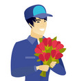 young asian mechanic holding a bouquet of flowers vector image