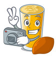 photographer lassi mango on the mascot table vector image vector image