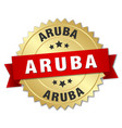 Aruba round golden badge with red ribbon