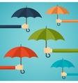 Hand of man holding an umbrella vector image