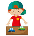 little boy playing toy cars vector image