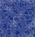 Pattern white abstract snowflakes on a blue vector image