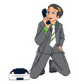 surprised businessman holding telephone receiver vector image vector image