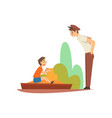 boy playing in sandpit in park or on playground vector image