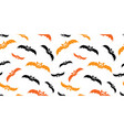 orange and black halloween bats seamless pattern vector image