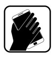 monochrome icon with hand holding a phone vector image