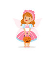 sweet little girl in halloween costume standing vector image