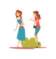 two smiling girls walking in park young women vector image