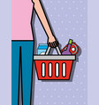female holds shopping basket with products vector image