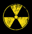 yellow radioactive sign over black background vector image