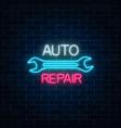 neon auto repair shop sign on dark brick wall vector image