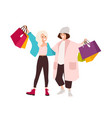 pair of happy teenage girls carrying shopping bags vector image vector image