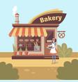 smiling girl baker character standing near bakery vector image