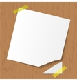 White reminder attached on wooden background vector image