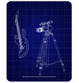 3d model of camera and guitar on a blue vector image