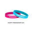 Two friendship bands with text