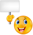 smiling emoticon holding a blank sign vector image