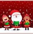 happy kids with santa claus singing christmas vector image