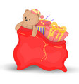 christmas red sack with gifts and toys cute vector image vector image