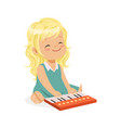 sweet blonde little girl playing piano young vector image vector image