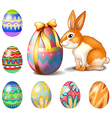 Seven Easter eggs and a bunny vector image vector image