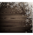 Winter wooden background with snowflakes vector image