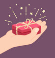 hand giving a gift vector image vector image