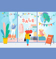 sale girl looks at the clothes shop window woman vector image