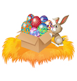A bunny pushing a box full of easter eggs vector image vector image