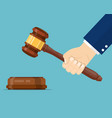 hand holding judges gavel vector image vector image