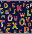 seamless background with colorful letters on dark vector image