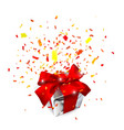 realistic gift box with red bow and confetti vector image vector image