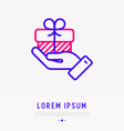 hand holding giftbox with ribbon thin line icon vector image vector image