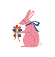 lovely pink bunny sitting with gift box cute vector image vector image