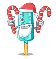 santa with candy ice cream shaped stick on mascot vector image