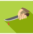 Hand holding knife with blood icon flat style vector image vector image