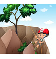 Boy climbing up the cliff vector image vector image