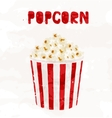 popcorn in striped bucket on white background vector image vector image
